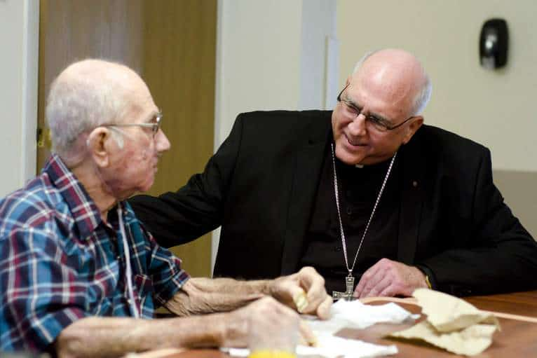 Hospice Patient with Archbishop Joseph Naumann