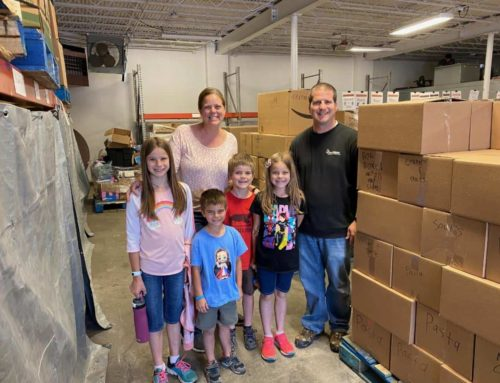 Family Serves Together to Help Neighbors in Need