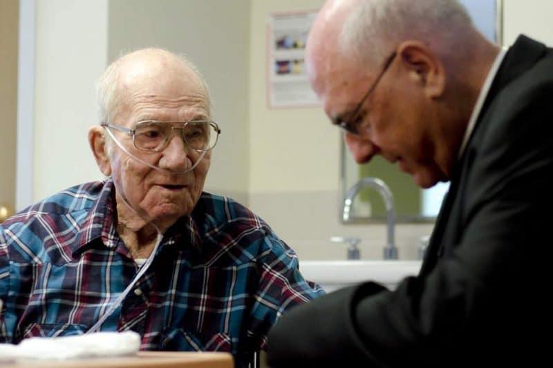 Hospice Patient with Archbishop Joseph Naumann