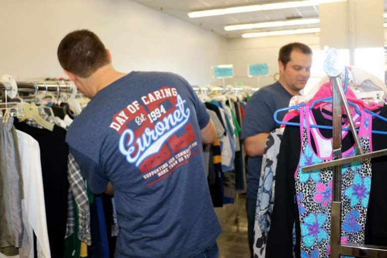 Corporate Group Volunteering at TurnStyles Thrift Store in Overland Park