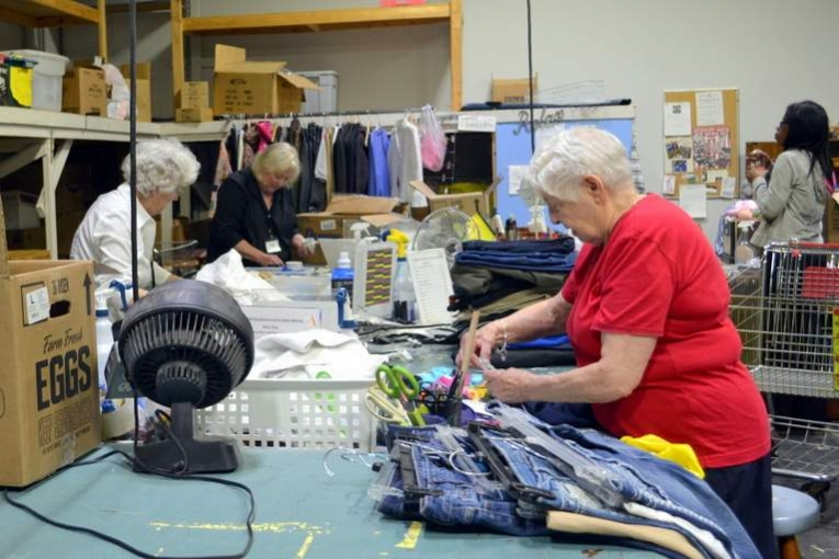 Volunteers Sort Clothing at TurnStyles Thrift Store in Overland Park